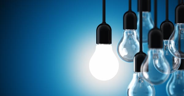 lightbulbs on blue background show ideas of patent and intellectual property