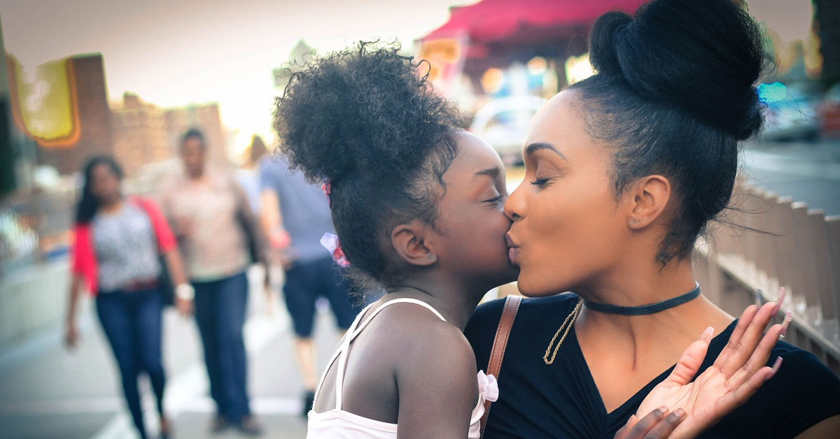 mother is kissing and has custody of daughter