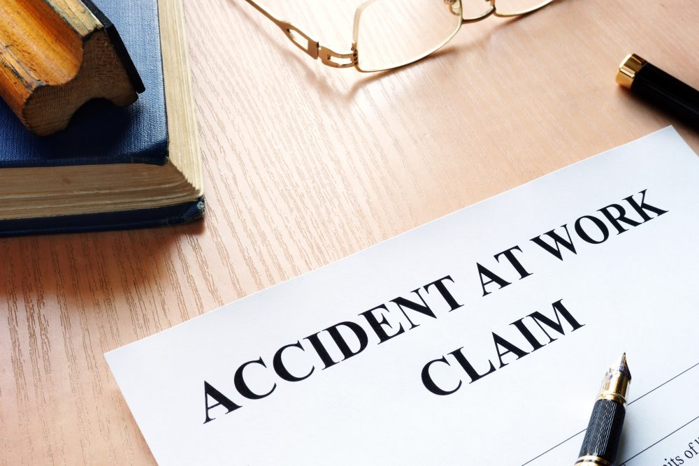 Accident at work claim and glasses on a table