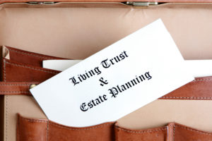 Estate planning documents in a leather briefcase revocable living trust