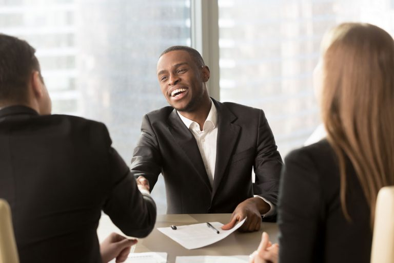 man shaking hands accepting job interview
