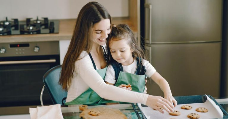 daughter baking with mother who received child stimulus payment support from family law attorney