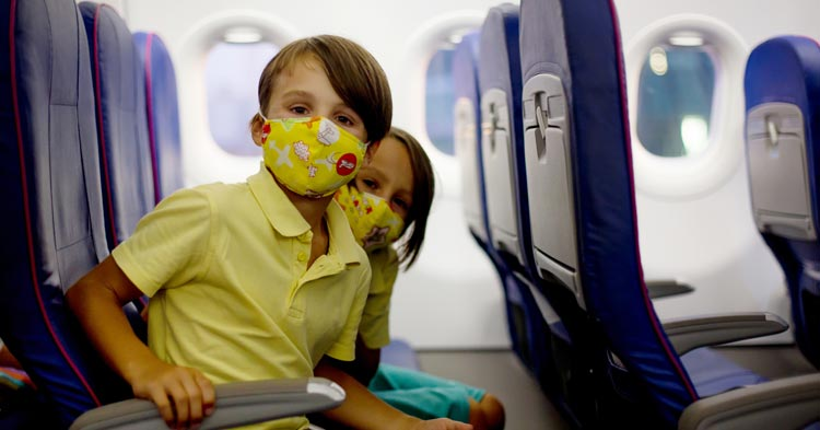 children travelling in a plane during covid whose parents are divorced who share custody