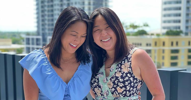High Swartz Law Firm Administrator Emily Bushnell hugs her long-lost twin sister Molly Sinert after meeting on their 36th birthday in Florida