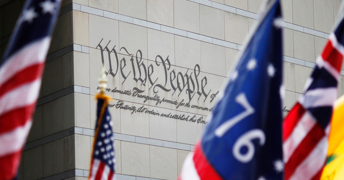 philadelphia constitution center We the People text with various american flags